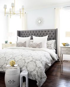 A brass chandelier and accents add modern sophistication to this elegant bedroom. Modern Elegant Bedroom, Elegant Bedroom Design, Elegant Home Decor, Master Bedroom Design, Beautiful Bedrooms, Home Bedroom, Bedroom Decor, Sophisticated Bedroom, Bedroom Designs