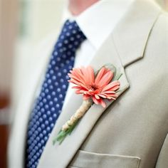 Coral Gerbera Daisy Boutonniere--I like the daisy wrapped in the tan/brown tape vs. green floral tape