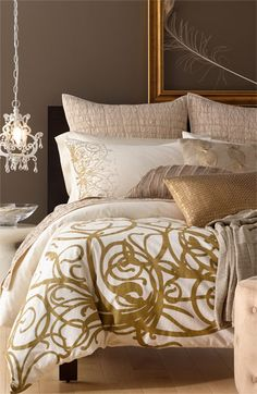 Gorgeous Bedroom. Loving the color palette, the swirl duvet, the cute little chandelier and all the great texture!
