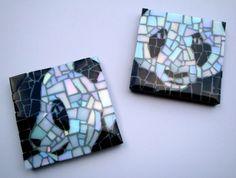 Two panda faces in mosaic