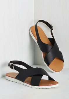 When the sun's at full amplitude, park it up in these black sandals! 'Rapping' around your feet with crisscrossing straps - secured to white soles - and silver-buckled slingbacks, these vegan faux-leather kicks offer a legendary mix of minimalism and total 'tude.