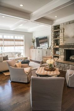 Shiplap walls, stone fireplace and hearth, timber floors, fireside chairs and coffered ceiling - perfect