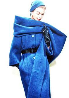 Model wearing an ensemble by Pierre Balmain, 1957.