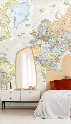 Give your teen a beautiful bedroom makeover with a fun and unique map wallpaper mural. This pastel coloured map wallpaper looks gorgeous placed behind a modern retro bed. Out of the ordinary a-symmetric headboards are so in style right now and will add some fun to your teen's bedroom! Choose terracotta and rust shades for a warm colour scheme and add white furniture to keep it modern and bright! Shop the look at Wallsauce.com