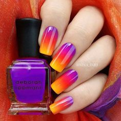 Flaunt your candy coated gradient nails in violet, red and yellow combination.