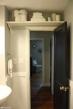 Ladder Not Included- over the door storage space! This would be so easy to DIY, just install the right size shelf!