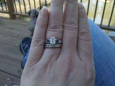 My wedding ring with new emerald cut center stone for our 5th anniversary.
