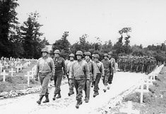 U.S. Army generals lead a procession for the funeral of Gen. Theodore Roosevelt Jr. in Normandy on July 13, 1944. Roosevelt died shortly after D-Day.