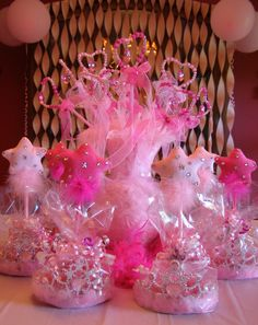 Princess Birthday Party Ideas.  Sparkling Beaded Wands arranged in a vase using boas and surrounded by Tiara and Plush Star Pen Favors. From our Pinkalicious Party. Shop for Princess Party Favors at www.myprincesspartytogo.com #princesspartyideas#pinkalicious #princessparty #princessfavors #princessbirthdaypartyideas