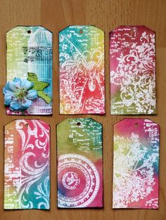 I created a set of tags that can be used on layouts or cards later. To achieve the same effect I stamped and embossed with clear embossing powder on white cardstock and then sprayed them with bright colors: Materials used: Glimmer Mist Key Lime Pie, Dragonfly, Olive Vine, Sun Sisters, Black Cherry, Burnt Red.