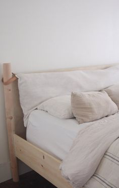 A headboard cushion with genuine leather cushion hooks to slide over the posters of an existing bed frame. Gives any bedroom a relaxed feel.