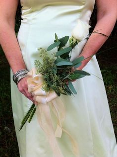 Rose Wedding Bouquet: Sometimes less is more, as is the case with this single stem rose bouquet. For those brides who don't feel comfortable rocking a heavy bouquet down the aisle, a simple white rose is just the ticket. Rose Bridesmaid Bouquet, Rose Wedding Bouquet, Diy Wedding Flowers, Bridal Flowers, Wedding Ideas, Wedding Greenery, Wedding Themes, Bridesmaids, Wedding Planning