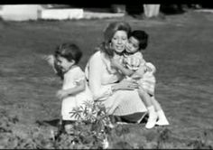 Queen Alia and her young children: Princess Haya and Prince Ali.