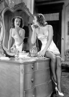 actress ANN SHERIDAN at pretty dresser/vanity--love the mirror a la 1940s ~ as seen at http://www.ann-sheridan.com/Ann_Sheridan_Interviews/Ann_Sheridan_John_Kobal_Interview.html