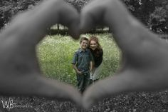 Dad is the left hand of the heart.. mom is the right hand side of the heart.. with kids shot through in the background