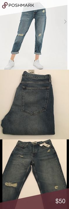 """Top shop Hayden Moto boyfriend jeans Medium blue wash Hayden loose fit authentic boyfriend jeans from Topshop. Part of the Moto collection, these cropped jeans have a button fly and a moderate amount of distress. Some small intentional """"grease"""" spots by the hips in the front. Length is designed for someone who typically wears a 32"""" inseam. Fabric is a soft cotton/lyocell blend. Machine wash/air dry Topshop Jeans Boyfriend"""