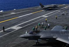 Two F-35C Joint Strike Fighter are shown after landing on the deck of the USS Nimitz aircraft carrier, off the coast of California, November 3, 2014. Two Lockheed Martin Corp F-35C fighter jets landed successfully on the USS Nimitz off the coast of San Diego on Monday, marking the new warplane's first landing on an aircraft carrier using its tailhook system REUTERS/Mike Blake (UNITED STATES - Tags: TRANSPORT MILITARY) Navy Marine, Marine Corps, Uss Nimitz, F35, Us Coast Guard, Flight Deck, Aircraft Carrier, San Diego, Air Force