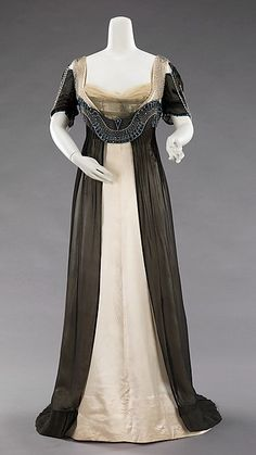 The Metropolitan Museum of Art Design House: House of Worth (French, 1858–1956) Designer: Attributed to Jean-Philippe Worth (French, 1856–1926)Date: 1909–11 Culture: French Medium: silk, metal, glass Dimensions: Length at CB: 67 in. (170.2 cm) Credit Line: Brooklyn Museum Costume Collection at The Metropolitan Museum of Art, Gift of the Brooklyn Museum, 2009; Gift of Mrs. Frederick H. Prince, Jr., 1967 Accession Number: 2009.300.1332