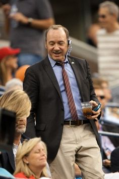 Kevin Spacey enjoys refreshing beverages as he watches tennis :)