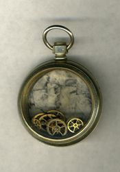 pocket watch, it may not tell time but it looks beautiful while doing so