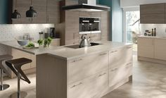 The superb C10, C11 & C12 Kitchen Collection by Bohen is all about creating depth and interest in your kitchen. It does this by employing a textured effect on the various units that make up the design, stunningly accented with champagne and brown grey finishes.