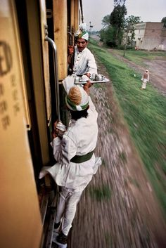 Chai wala's In India passing tea from train car to train car!