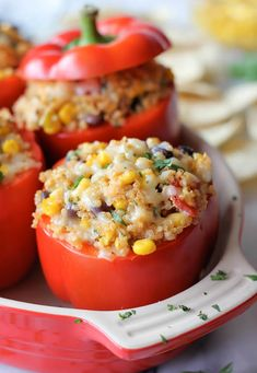 Quinoa Stuffed Bell Peppers 3 cups cooked quinoa 1 (4-ounce) can green chiles 1 cup corn kernels 1/2 cup canned black beans, 1/2 cup petite diced tomatoes 1/2 cup shredded pepper jack cheese 1/4 cup crumbled feta cheese 3 Tcilantro 1 teaspoon cumin 1 t garlic powder 1/2 t onion powder 1/2 t chili powder, salt  black pepper 6 bell peppers,