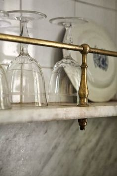 Image result for marble ledge with brass rail