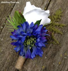 Rustic style boutonniere with a white sweetheart rose, blue cornflower / bachelor button, fern, pine cones, evergreen sprig, and a jute wrapped stem. Design: SomethingFloral  Photo: Urban Fire Studio #blue #white #boutonniere #buttonhole #rose #cornflower #bachelor #button #fern #pine #cone #evergreen