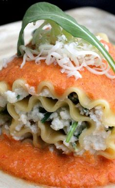 Arugula Lasagna Roll Ups with Red Pepper and Goat Cheese Sauce