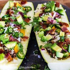 Zucchini Boats! Made with @5280meat Smoked Bacon, Ground Beef, and Shredded Pork layered with @kerrygolddairy Swiss Cheese and seasoned with @flavorgod Chipotle seasoning.