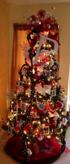 """My Bedroom Christmas Tree.  Family Pictures on Tree.  Red & Silver Tree Topper.  Monogram """"P"""""""