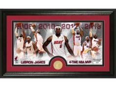 """The Highland Mint Commemorates Lebron James and his 4th NBA MVP Award! This unique 12 x 20 frame with a glass front panel features in double matting a 7""""x15"""" photo custom collage of Lebron James combined with a minted Bronze 39mm Miami Heat Commemorative Coin."""