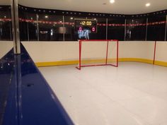 Basement rink by Omni Sport Inc with synthetic ice floor Synthetic Ice Rink, Home Lottery, Hockey Decor, Hockey Boards, Red Wings Hockey, Hockey Training, Basketball Court, Hockey Stuff, Full House