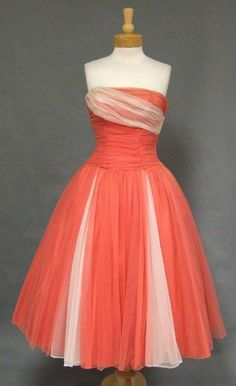 1950's Looking at this dress just made me realize why I love vintage glamour so much, BARBIE!  Her gowns swoon