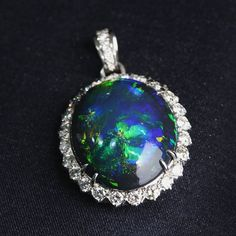 October babies, it's your birthstones' time to shine. Stunning 25ct black opal and diamond pendant. #joganibh . Shot by @jilliansorkinphotography . . #octoberbirthstone #opal #blackopal #October #diamond #fall #love #australia #pendants #jewelry #whitegold #birthstone #ovalcut