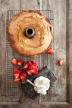 Paula Deen Never-Fail Pound Cake:  1/2 cup (1 stick) butter, softened   3 cup sugar, 5 eggs, 3 cup cake flour,   1 cup milk, 2 tspn lemon extract,   vanilla ice cream, berries for garnish  10-inch bundt pan, greased and floured.  ... Place pan in a cold oven and heat oven to 325 degrees F. Bake cake for 1 hour. Increase the temperature to 350 degrees F and bake for 30 minutes more.