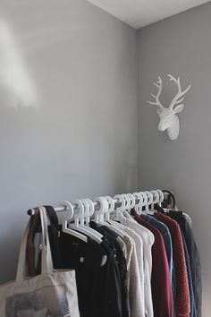 "Sneak Peek: Belinda Love Lee. ""I love the rawness of clothes hanging on a rack in a room. I feel that my personal clothing really adds as decoration. The Stag's head was purchased from Next Home."" #sneakpeek"