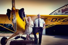 love any aviation themed shoot. Love the Cub. Funny the guy's got an airline uniform next to a Cub though!! :)
