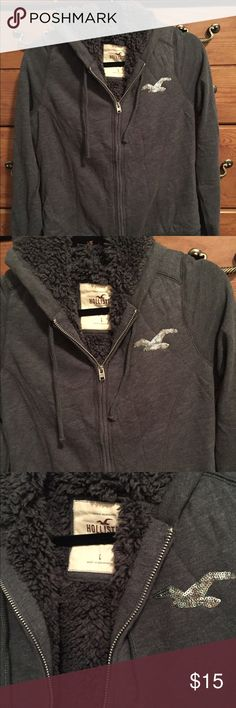 Hollister zip shag hoodie This jacket has a lovely shag inside that is sooo fluffy & warm. There are no hand pockets on this piece. Sequined silver logo on left side of chest. Hollister Tops Sweatshirts & Hoodies