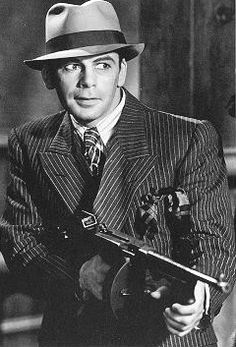"""gangster Paul Muni in the classic movie """"Scarface"""", co starring Georgie Raft! Scarface 1932, 1920s Gangsters, Public Enemies, Troll, Gangster Movies, Gangster Costumes, Gangster Style, Legs, Black And White"""