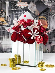 Accessorise compact floral displays with playing cards and casino tokens