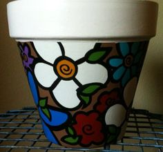 Check out this item in my Etsy shop https://www.etsy.com/listing/225772996/hand-painted-terracotta-pot-cute-light