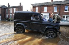 The Land Rover was used to help those affected by the floods in December - pictured here is Margaret McCraken, 79, in Carlisle