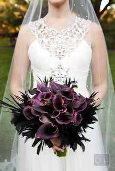 I don't think that I would ever do something like this but the color contrast between the pure white dress and the deep purple flower bouquet is BEAUTIFUL and very pleasantly shocking...