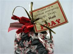 """This tootsie roll filled bag has a tag that reads, """"In case of a spiritual emergency... STOP, DROP and PRAY!'   Two truffles are tied to the outside with ribbon."""