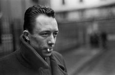 Camus. When not writing on L'Étranger he probably liked to walk around in his trench coat looking ... well, suspicious.