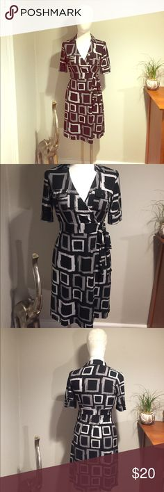 Patterned Faux wrap dress size small Black, white and gray patterned faux wrap dress in size small. Hits mid thigh, has a collar, pockets on the chest and sleeves that hit above the elbow. Wonderful dress! Apt. 9 Dresses