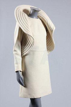 A Pierre Cardin cream wool crêpe 'circle' jacket and mini-dress ensemble, circa 1969
