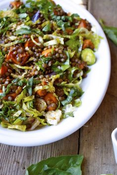 French Lentil & Vegetable Salad with shaved Brussels sprouts and roasted butternut squash. Could top with some goat cheese